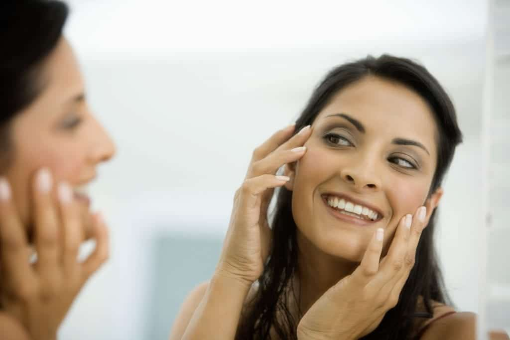 Woman examining complexion