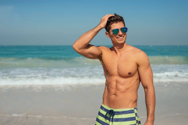 Handsome,Smiling,Man,Enjoying,Day,On,The,Beach.